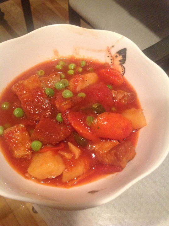 pork belly in tomato sauce with potatoes and carrots