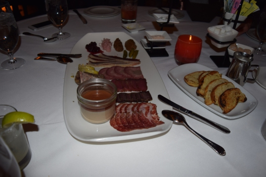 Charcuterie Plate (selection of house cured meats,Saskatoon berry reduction,pickled shallots,Guinness mustard,cornichons)
