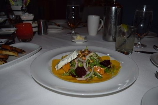 Roasted Beet Salad (organic greens,shaved purple onions,salt brined pistachio nuts,champagne chèvre vinaigrette,Humboldt Fog)