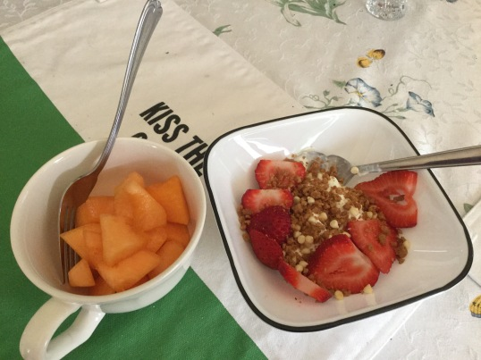 Breakfast for my hubs! yogurt with strawberries and bowl of cantaloupe!